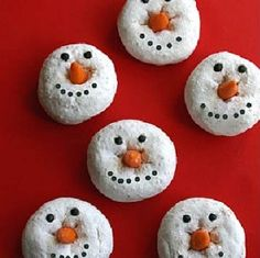 Donut Snowmen  Drop a candy corn down in a mini powdered sugar donut. Use melted chocolate for the eyes and mouth (not icing cause it won't stick)