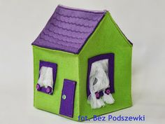 Toy-house. The task is to guess what's inside. Without looking! Using only hands. (You put them inside through the windows)