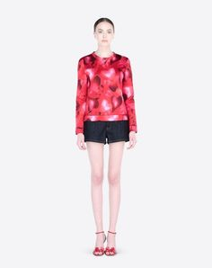 Crew neck Valentino sweatshirt in camuamour print modal. The heart camouflage pattern was created in collaboration with artist Giosetta Fioroni.