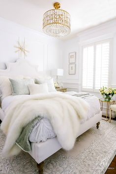 glam chandelier - luxe bedroom - white walls - wainscoting -Glam Guest Bedroom Makeover