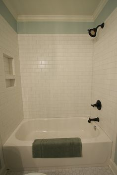 white subway tile with shower niche