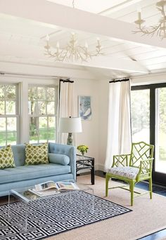 Layering a smaller, patterned rug over a larger, neutral sisal is a great way to splurge on a more expensive wool rug while still having the proper rug sizing for the room.