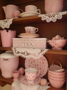shabby chic tea...dishes...shelf...some vintage?...love the pink tea box!