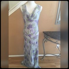 ✨Gorgeous Floral Dress✨ Only worn for a few hours to a wedding. Can be worn as causal or formal. I purchased at Saks. Gorgeous purple sequins mix in dress. PositiveAttitude Dresses Maxi