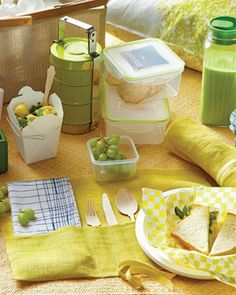 planning perfect picnic foods - salads in white chinese boxes, sandwiches wrapped in parchment paper and cool green grapes!  #indigo #perfectsummer.