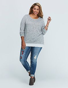 This top goes a step above the layering trend -- that back zip means you can conceal or reveal as much of the sheer layer as you want. lanebryant.com
