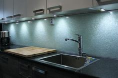 Essis kitchen wall panels, which glitter beautifully in light, are hand-crafted from recycled crushed glass with measurements ordered by the client. Kitchen Wall Panels, Crushed Glass, Recycled Glass, Backsplash, Recycling, Sink, Smooth, Glitter, Cleaning