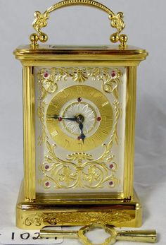 Igor Carl FABERGE Carriage Clock.This is an amazingly beautiful FABERGE piece that has fabulous detail, a fancy brass dial and had (10) genuine rubies set in it. This clock is practically in MINT Condition. (Est Value $2200-$2400