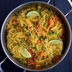 Vegetable Singapore noodles are a great weeknight dinner. Stir-fried mixed veggies served with curry flavoured rice vermicelli noodles and a squeeze of lime. A great vegetarian or vegan main dish. Rice Recipes, Veggie Recipes, Asian Recipes, Whole Food Recipes, Vegetarian Recipes, Dinner Recipes, Cooking Recipes, Healthy Recipes, Ethnic Recipes
