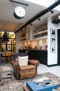 My Houzz: A Garage transformed into a boy's dream pad - eclectic - living room - amsterdam - Louise de Miranda  - Love the strip of lighting over hte kitchen counter