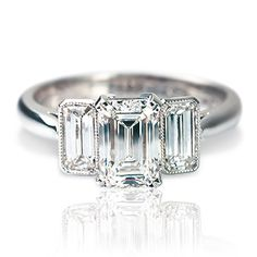 Rosendorff Emerald Cut Diamond Ring - 18ct white gold diamond ring featuring three emerald cut diamonds claw and bezel set complimented by a delicate millgrain finish.