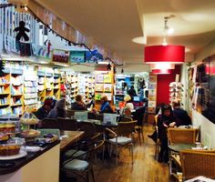 Cosy in the café at Christmas time 2015, with the lovely glow from the new lighting, & pink & green walls!
