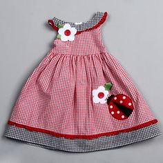 @Overstock.com.com.com.com.com.com.com.com - A two color schemes of a checkered print and ruffled details on the collar and skirt highlight this darling Good Lad dress. Lady bug and floral embellishments complete the look of this adorable dress. http://www.overstock.com/Clothing-Shoes/Good-Lad-Toddler-Girls-Ladybug-and-Flower-Embroidered-Dress/6608747/product.html?CID=214117 $23.09