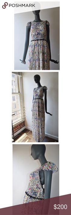 "Free People Cherry Blossom Maxi Dress Sz 8 - Shell (first layer) is a floral lace made from nylon  - The lining is polyester. There is a cropped bralette style lining on the top of the dress & separate lining for the skirt that is above the knee. - Side zipper &a button closure  - Cap sleeves - BRAND NEW - extra buttons included  - Sz 8 - Bust 34"" - Waist 29"" - Slip length 18"" from waist - 100% authentic  - NO TRADES Free People Dresses Maxi"