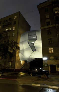 parasite office - light up at night, like a lamp shade..
