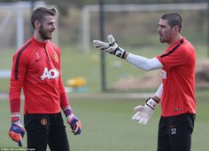 Goalkeepers David de Gea (left) and Victor Valdes (right) in action during a training session on Friday