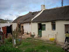 How can a picturesque South African village still deeply divided by the legacy of apartheid accomodate much-needed government housing without ruining their tourist economy? How can the town create … Old Cottage, South African Artists, Country Farmhouse, Small Towns, Cottages, Gazebo, Brick, Castle, Farm Houses