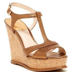 """Vince Camuto Gold Wedge Sandals Details: - Peep toe - Adjustable side buckle strap closure - T-strap vamp - Embossed lizard print construction - Cork wedge heel with metallic detail - Approx. 4.5"""" heel, 1.25"""" platform - Imported Materials: Leather upper, manmade sole Vince Camuto Shoes Wedges"""