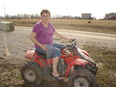 Me on one of the 4 wheelers at Penny and Chris's on spring break