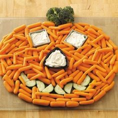 Healthy Halloween ideas! Plate of carrot sticks, cukes for the mouth, broccoli for the stem and little dishes filled with dip for the eyes and nose! So cool looking, healthy and fun! #Halloween #healthy #food