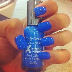 """Sally Hansen's """"Pacific Blue"""" Love this! <----- I do love these however, before you go and buy this you should know the polish WILL NOT make your nails look perfectly shiny and kind of like a bubble. The way to do that is to ask for """"gel nails"""" at the salon and it will give this effect. ( gel nails cost A LOT more but they are too gorgeous)"""