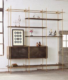 could be such an easy diy with copper pipes and a diy box with sliding doors