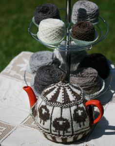 [Sheep Carousel tea cosy, by Kate Davies]