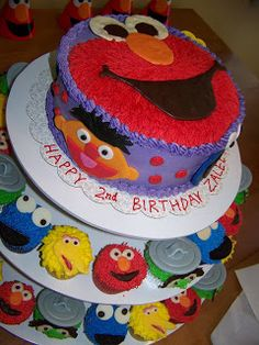 Sesame Street Birthday Cake & Cupcakes - i like the purple on the cake with the red.  makes it more girly!