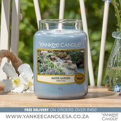 Water Garden Soothing reflections…pretty water flowers and lush green notes with hints of melon and musk. Fragrance Notes: Top: Lemon, Orange, Watery Mid: Rose, Muguet, Green Lily Base: Woody, Musk Top note is the initial impression of the fragrance, middle note is the main body of the scent, and base is its final impression. Water Garden is Fresh & Clean. Shop Online: www.yankeecandlesa.co.za Water Candle, Candle Jars, Water Flowers, Fresh And Clean, Lush Green, Water Garden, Woody, Scented Candles, Lemon