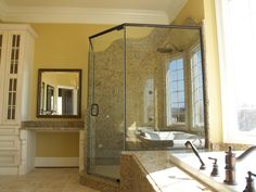 """Neo angle shower in oil rubbed bronze and 3/8"""" thick clear glass. Visit Showroom Partners online. We can improve your entire home."""