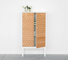 Collect cabinet by Swedish Sara Larsson/A2. The cabinet has a fish scale patterned front made in Tärnsjö leather and comes with a signed and numbered metal plate.