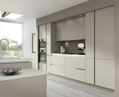 Novi warm grey – this smooth designed kitchen door can make the perfect mix and match for any kitchen and is part of our Horizon handleless kitchens range  http://www.moores.co.uk/Definitive-Kitchens/Range-Selection/Novi/123/Warm%20Grey/2/8