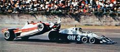 Gilles Villeneuve trying to climb over the back of Ronnie Peterson at the 1977 Japanese Grand Prix.