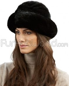 Mink Fur Roller Hat with Mink Top - Black. This ladies fur roller hat features a wide band of natural ranch raised mink fur with soft black mink fur on the crown. Stretchable elasticized interior brim for a perfect fit every time. An absolutely exquisite has that will keep you looking your best, no matter what.