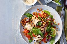 A Middle Eastern staple, smoky aubergine is right at home matched with tangy halloumi, harissa-chickpeas and a tahini dressing in this vegetarian lunch.