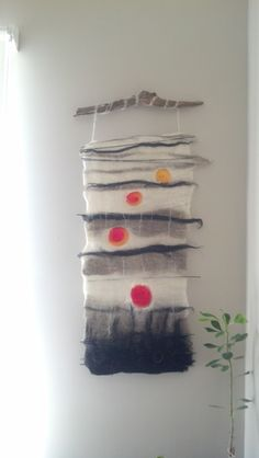 Wet felted wall hanging.By Rosalia