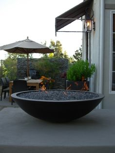 Concrete fire bowl / crushed glass