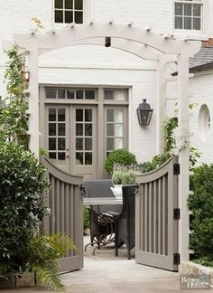 I great way to divide the side garden from the main garden making a dog friendly area pergola gate Color crush- Gray and white (The Enchanted Home) Paint Colors For Home, White Brick Houses, White Brick, House Paint Exterior, House Painting, House, Outdoor Living, Painted Brick, Exterior House Colors