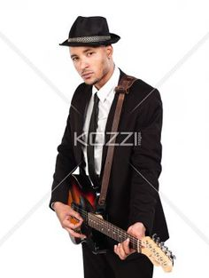 businessman playing guitar. - Portrait of a businessman playing guitar, Model: Kareem Duhaney