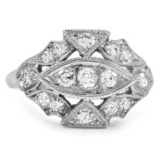 The Jani Ring, 1940's Retro, diamonds in 14k white gold [Unusual tilting of settings lets diamonds be seen from all angles. Interesting ring.]