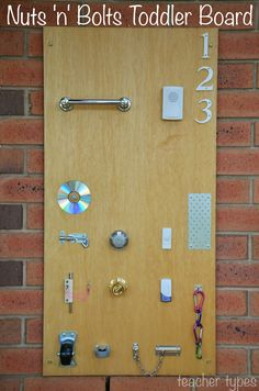 Nuts 'n' Bolts Toddler Board. Is your toddler obsessed with keys, door knobs, door bells? Here's a great idea to keep them amused! | teachertypes.blogspot.com.au