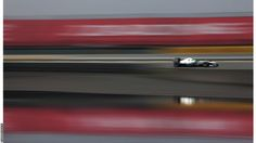 Nico Rosberg in practice at Turn 13 in China (by Darren Heath)