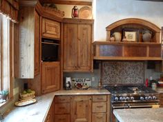 Timberline Framers Inc, Pagosa Springs, Colorado. Custom built cabinets in kitchen showing display cove over stove and granite counter tops.