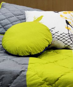 Bird artworks adorn our quilted bedding