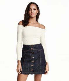 Denim Skirt | H&M US DESCRIPTION Short skirt in stretch denim with buttons at front and decorative seams. DETAILS 99% cotton, 1% spandex. Machine wash warm Imported Art.No. 21-9703
