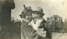 Eleanor Roosevelt shown holding her son, Elliott, near their family home at Campobello, New Brunswick. This photo was taken on August 14, 1913, likely by FDR. ♡❀♡✿♡❁♡✾♡✽♡❃♡☀♡   http://en.wikipedia.org/wiki/Eleanor_Roosevelt http://www.fdrlibrary.marist.edu/education/resources/biographies.html    http://en.wikipedia.org/wiki/Franklin_D._Roosevelt http://en.wikipedia.org/wiki/Campobello_Island