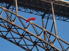 To give you some perspective, this is a BASE jumper on Bridge Day, floating in front of the New River Gorge Bridge.