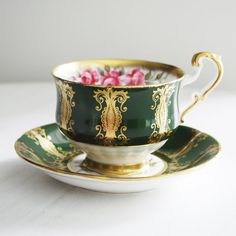 Paragon Teacup and Saucer Green and Gold with Pink Roses