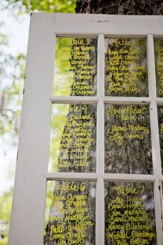 for outdoor wedding: door as escort cards. save paper and recycle old doors/windows!