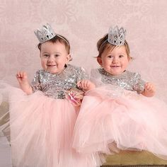 Silver sequin and pink tulle dress. Satin bow on the back with petal details. Cotton lining underneath the dress. Offered by Baby Boutique - Itty Bitty Toes!